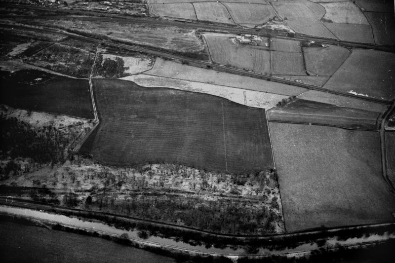 Oblique aerial view of the Antonine Wall and site of the fortlet at Seabegs Wood from the north, centred c. NS 8126 7927.