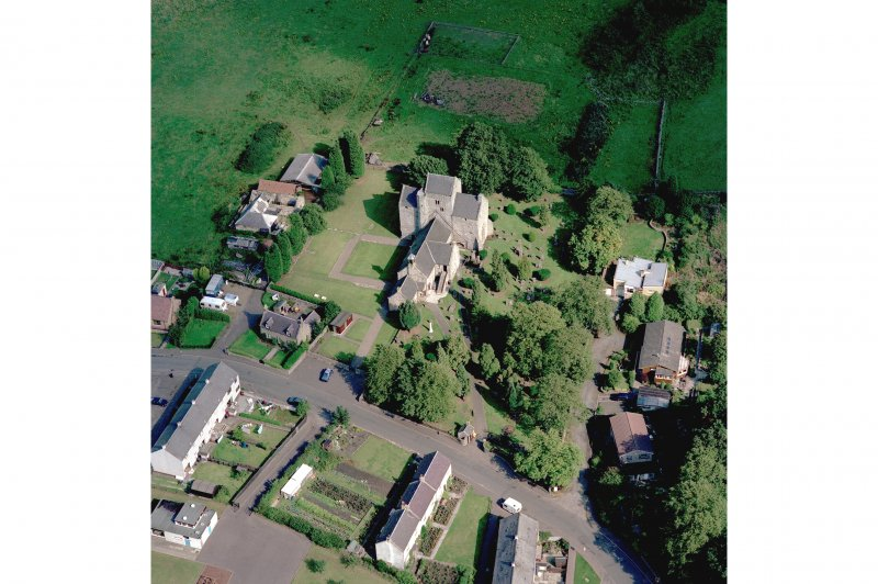 Oblique aerial view of Torphichen Preceptory. The central part of the medieval church, comprising the 13th century tower and the N and S trancepts, survives. The present parish church, built in 1756, overlies the foundations of the medieval nave.