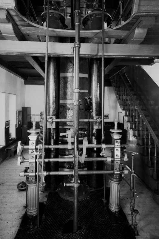 Interior. View of steam cylinder and cut-out valves on ground level.