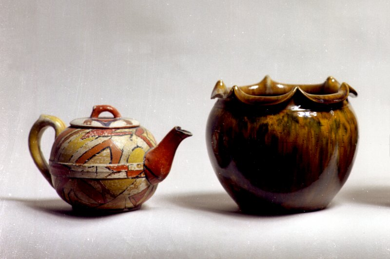 View of Dunmore ware teapot and scallop-edged vase.