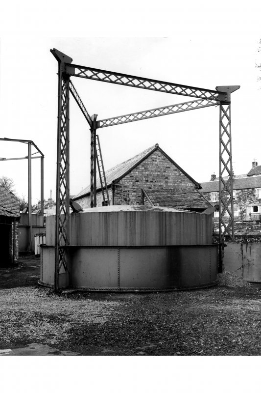 View of gasholder with triform latticed hoisting posts.