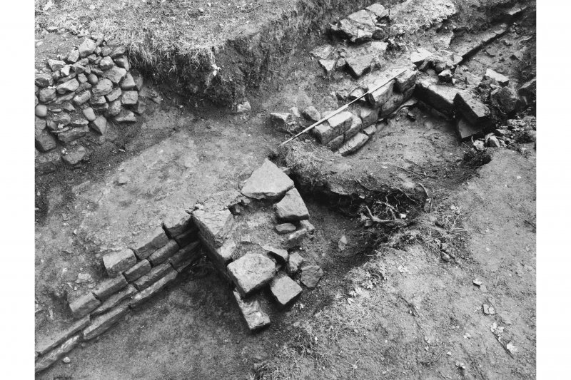 Excavation photograph showing the buttress of wall of second century granary or stone building.