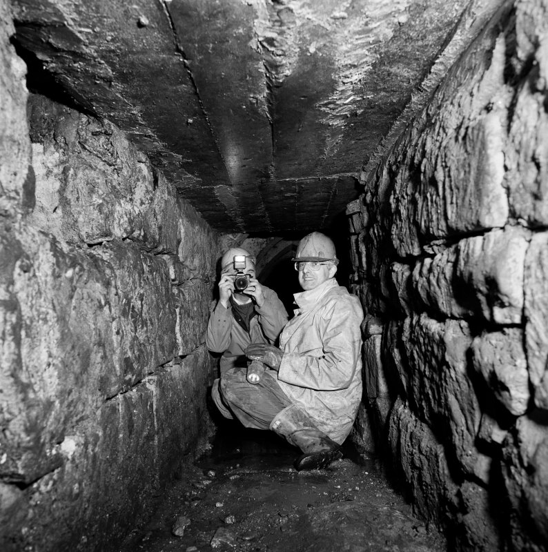 Interior. View of drain with John Maldon of Paisley Museum and Jim Mackie, RCAHMS photographer.