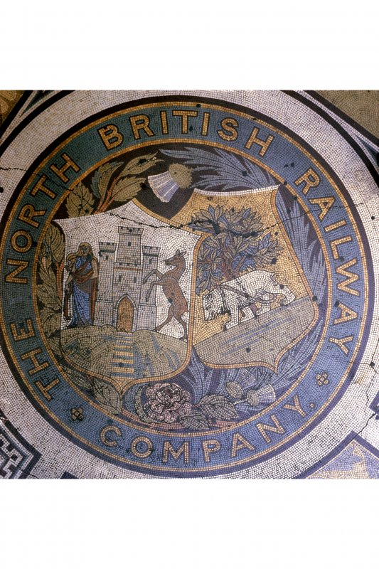 Mosaic in the Booking Hall at Waverley Station, Edinburgh, with the North British Railway Crest in the north east angle.
