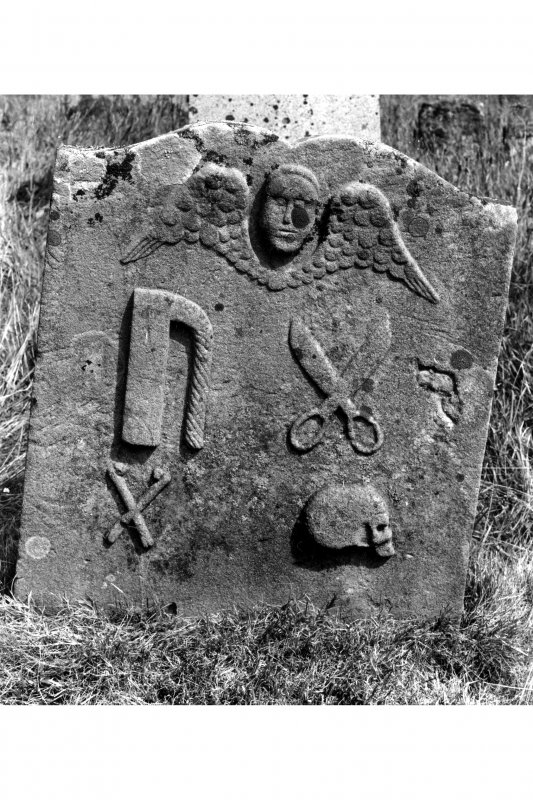 Kilbrannan Chapel, Kaymand Tombstone. Detail of Kaymand tombstone in churchyard, dated 1727 and with tailors' insignia, including an iron and scissors.