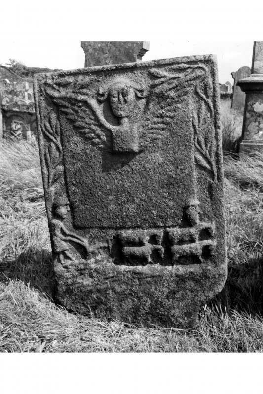 Kilbrannan Chapel, McKinnin Tombstone. Detail of McKinnin tombstone in churchyard, dated 1793, with a ploughman and plough team.