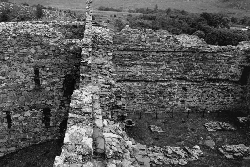 Castle Sween, interior. General view of North wall-head showing kitchen tower and courtyard.