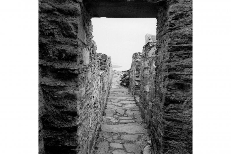 Castle Sween, interior. General view of East wall-walk from North-East turret.