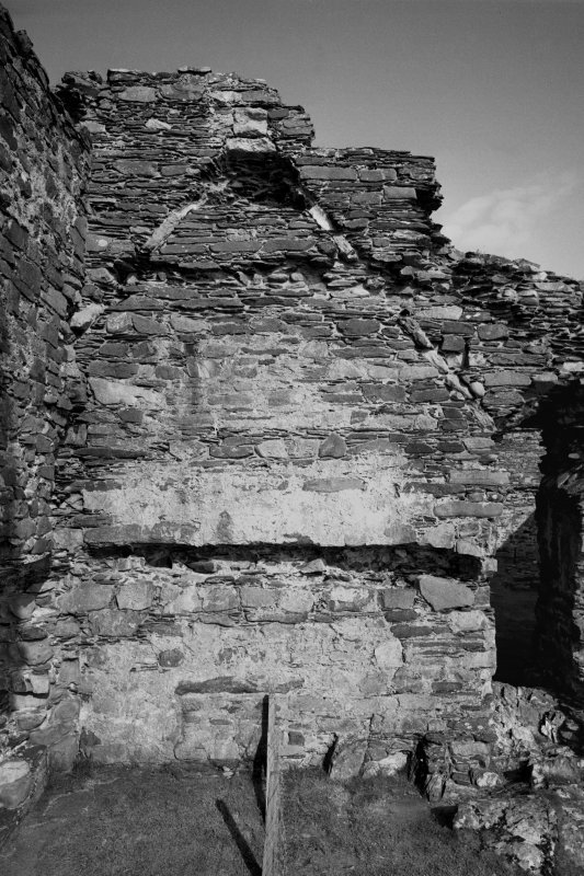 Castle Sween, interior. View of North-West platform on East wall, showing roof raggle and postern.