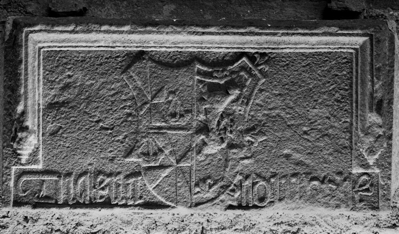 Carnasserie Castle, interior. Detail of inscribed panel above entrance doorway.