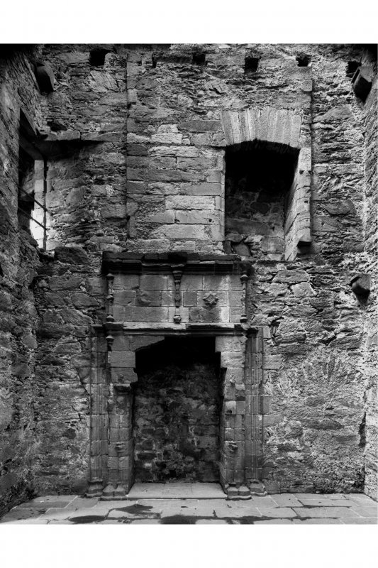 Carnasserie Castle, interior. General view of first and second floor fireplaces in North wall of East tower.
