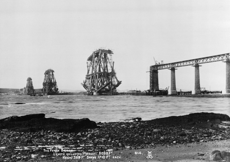 View of the Forth Bridge under construction.  Titled: 'The Forth Bridge. Length including Viaduct 8098 Ft. Height 369 Ft. Spans 1710 Ft each.  614'