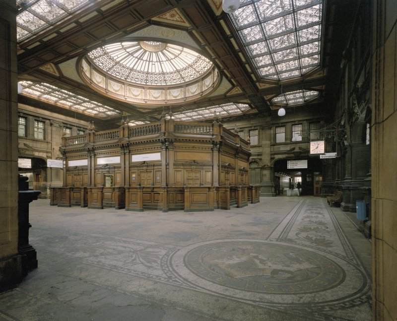 The Booking Hall at Waverley Station, Edinburgh showing mosaic floor, wooden booking office (now removed) and glass ceiling.