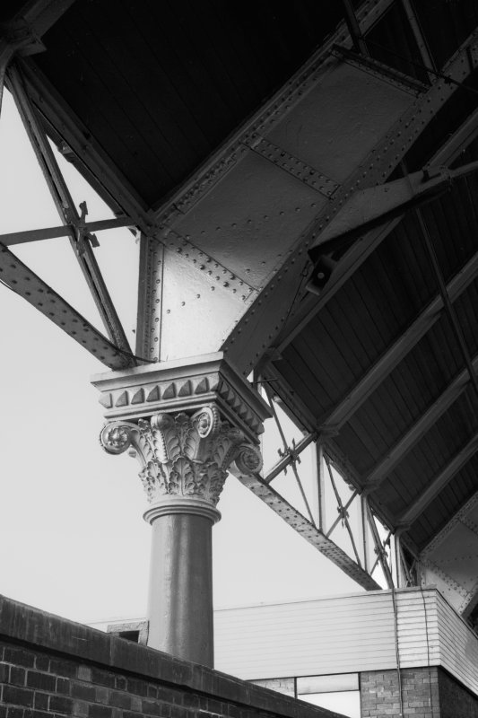 Interior. Detail of structural support in train shed, showing corinthian capital to column.