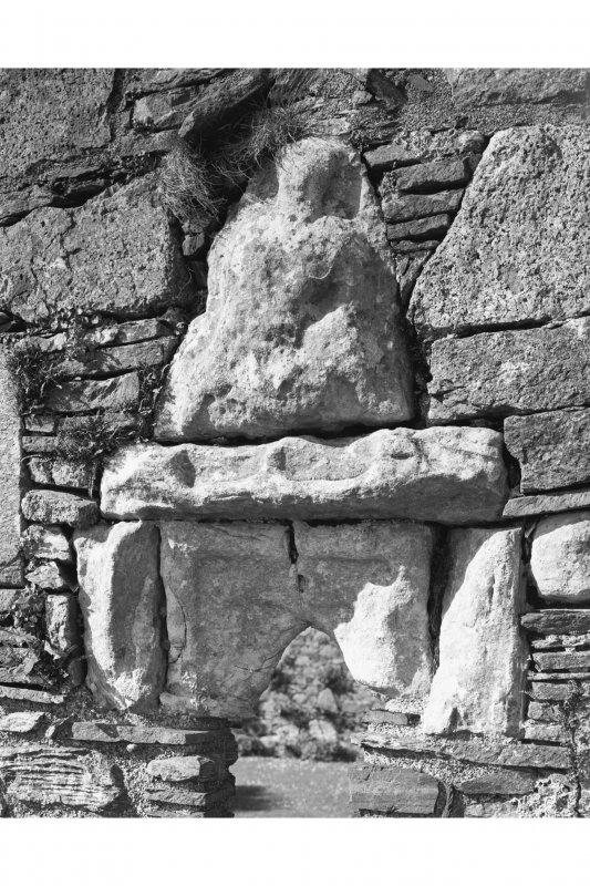 Iona, Iona Nunnery. Detail on refectory showing sheila-na-gig carving on exterior of South wall.