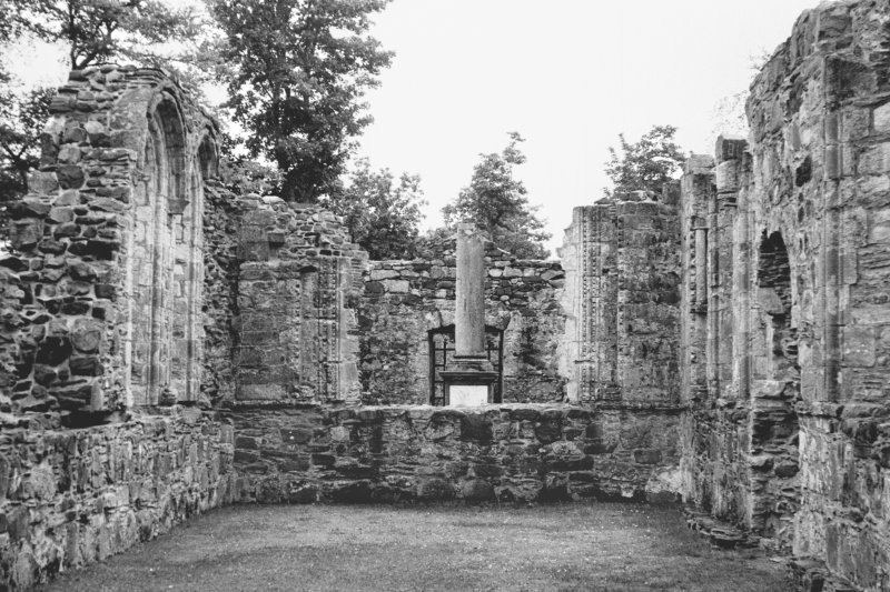 Dunstaffnage Chapel, interior. General view of chancel and possible font from West.