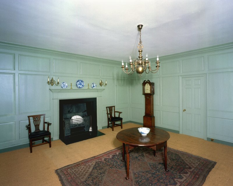 First Floor, West Room, view from South East, showing furnishings and longcase clock.