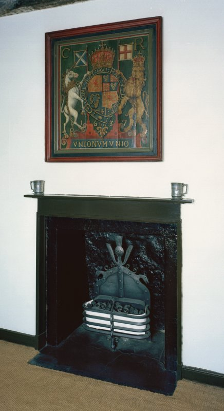 First Floor, East Room, detail of fireplace and painted heraldic panel.