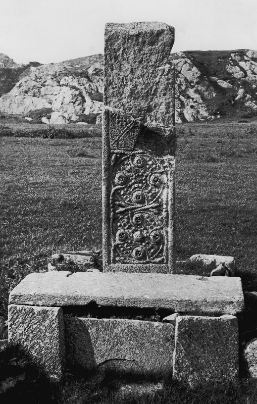 Iona, St John's Cross. View of fragments of shaft and base. Copy of original mounted photograph annotated by Erskine Beveridge 'Bossed Cross (near St Martin's), Iona (from east)'. From RCAHMS Society of Antiquaries Collection MS/36/209.