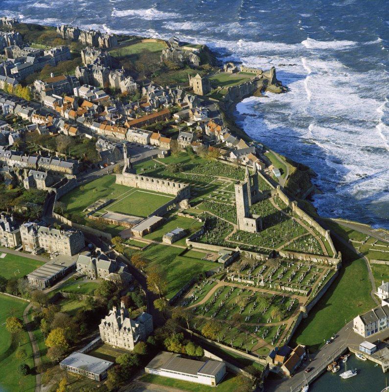 Oblique aerial view of St Andrews centred on the Cathedral and Castle from South East.