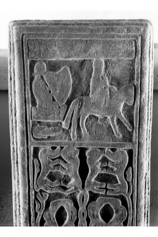 Iona, Iona Abbey museum. View of medieval grave-slab showing detail of upper panel, showing harpist and horse rider.