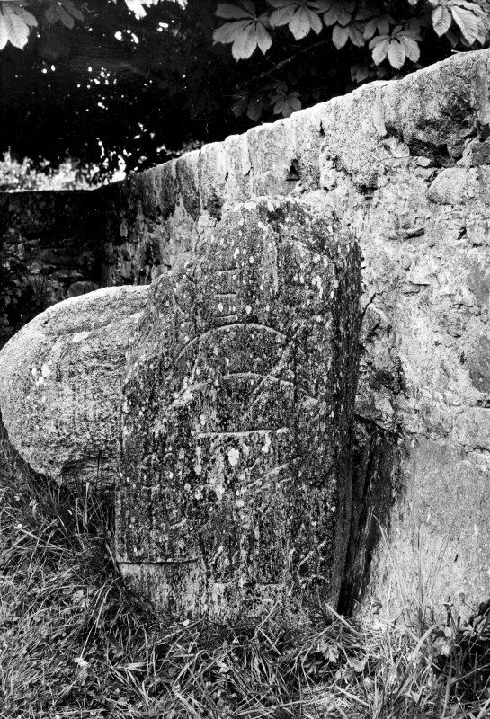 Inverallan Pictish symbol stone bearing crescent and V-rod and notched rectangle and Z-rod. Behind it a 'font'. Original negative captioned: 'Sculptured Stone and Font, Inverallan, Grantown, Inverness. 1910'.