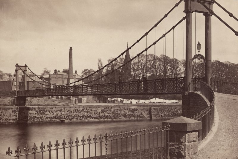 Historic photograph showing general view of suspension bridge.