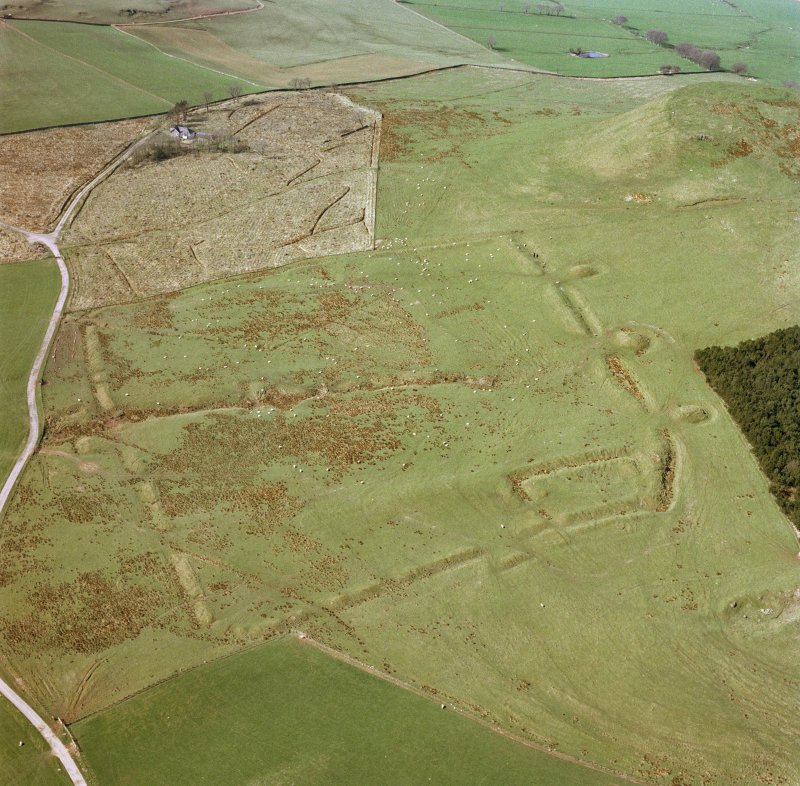 Oblique aerial view of Burnswark Roman Fort, siegeworks and other sites.