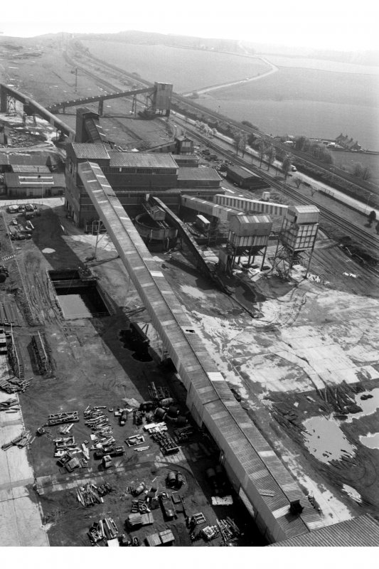 View from the top of No.1 winder's tower (from the North) of gantry containing two conveyors leading to coal preparation plant (made by Simonacco of Carlisle in 1960s), Seafield Colliery