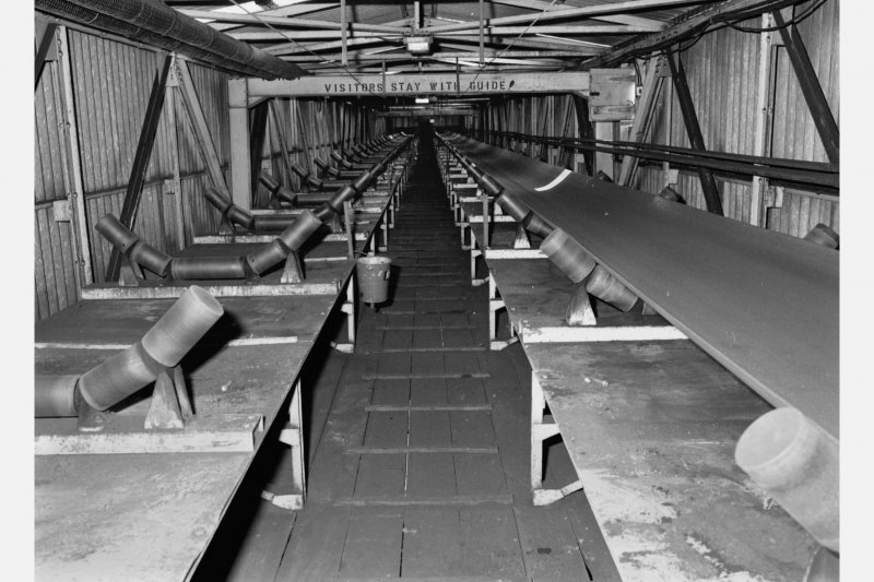 View inside the conveyor gantry containing two belt-conveyors (one with belt removed) carrying coal to the preparation plant (conveyor belt 1.3m wide), Seafield Colliery