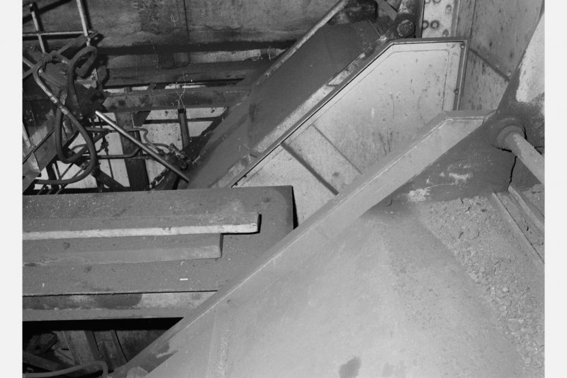 No.1 shaft - detail at top of shaft showing two chutes down which coal is emptied from full skips raised up the shaft (payload 15 tons per skip), Seafield Colliery