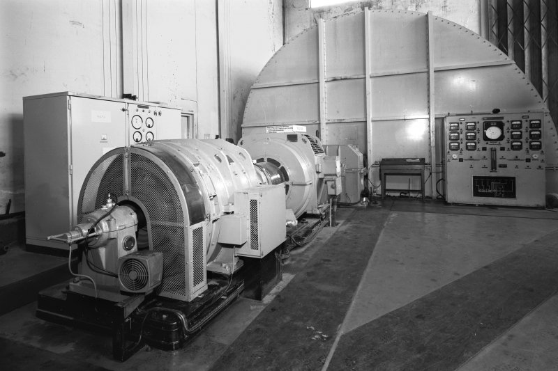General view of one of two identical fans, made by Mather and Platt of Manchester, driven by 3,300 volt, 160 amp motors (1030 BHP, 750/740 RPM), located on the upper floor of the fan house.  Each fan, operated seperately, provides 212.4 cubic metres of air per second at 2490 N/sqm.  In cold conditions the air can be heated.