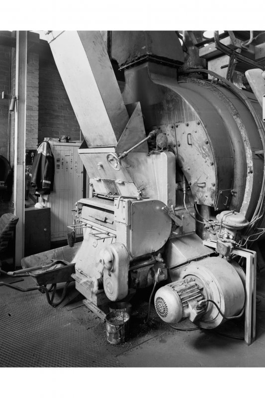 Detail of one of two Penman Cornish-type coal-fired boilers in boiler house, with Olbury chain-grate automatic stoker, fed from above by a coal elevator made by Proctor of Burnley, Lancashire.