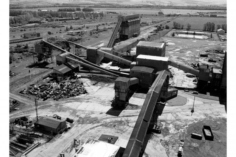 General view from NW of No. 2 winding tower of covered belt-conveyors, coal preparation plant, railway sidings, rapid-loading surface bunker, and two settling ponds at far right.