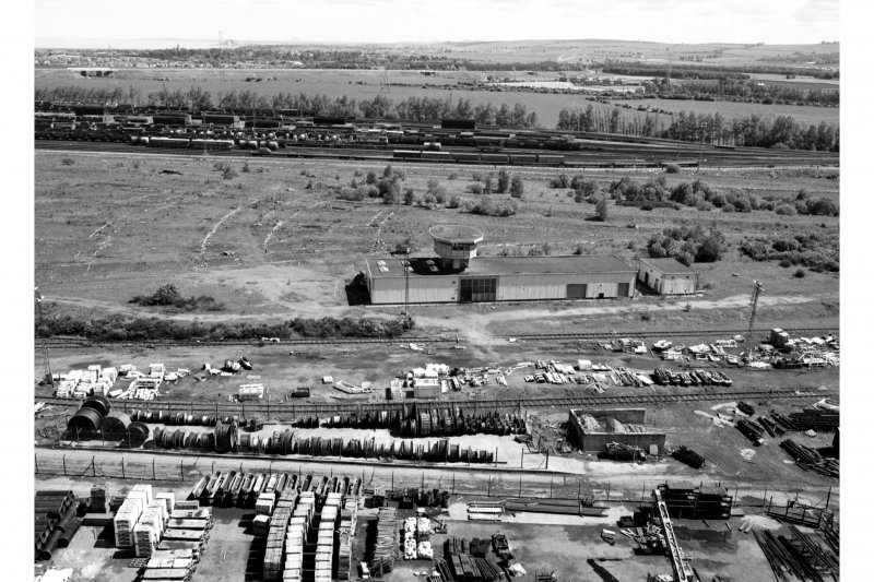 General view from W of top of No. 2 winding tower of part of mine compound, railway sidings and sidings control building, and British Rail sidings in background.
