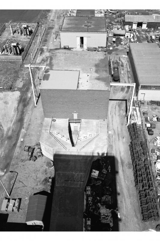 General view of fan house from West on top of No. 2 winding tower.  The fanhouse contains two identical fans (one in use, one on standby), made by Mather and Platt of Manchester.  Each fan provides 212.4 cubic metres of air per second at 2490 N/sqm.  In cold conditions, the air can be heated using oil-fired heaters.