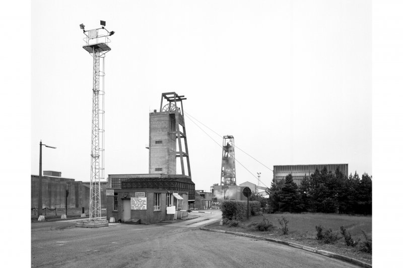 General view from W of weighbridge, 100,000 gallon water tank, no. 2 shaft headframe and winding engine house, and no. 1 shaft headframe.