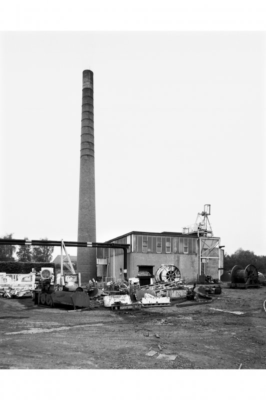 General view from SW of Boilerhouse, ash hopper and chimney stalk.