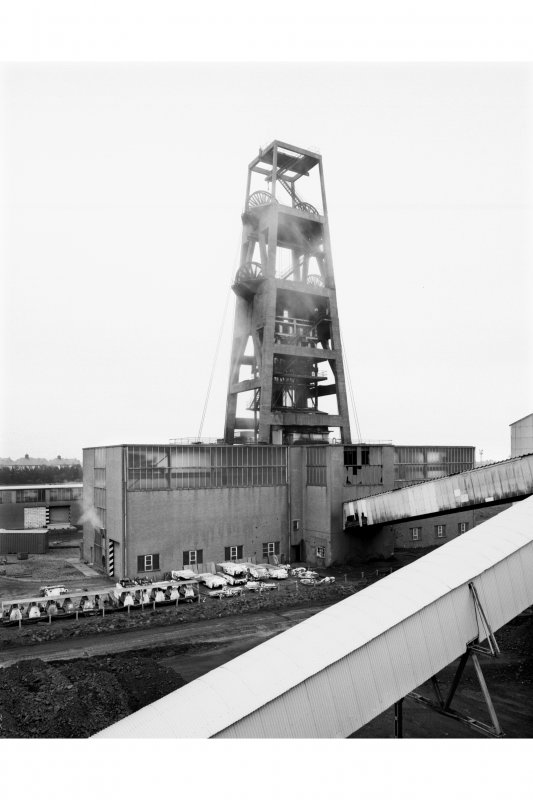 General view from SW of no. 1 shaft headframe, and two ground-mounted winding-engine houses.