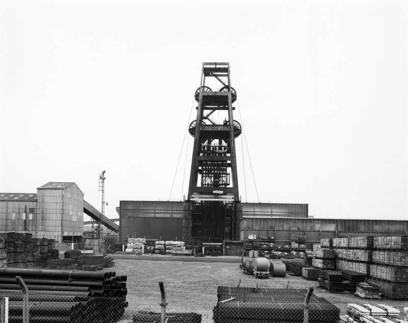 General view from NNE of no. 1 shaft headframe, and two ground-mounted winding-houses.