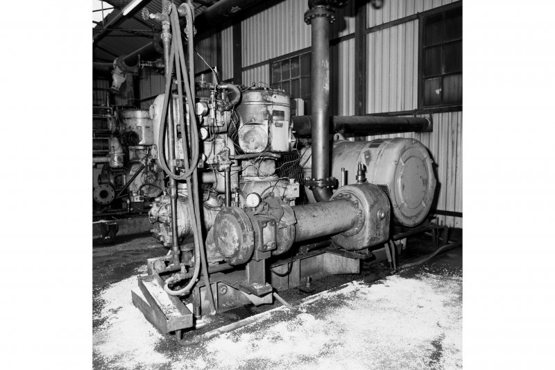 Interior. View of ATLAS-COPCO air compressor.