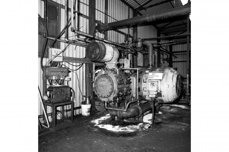 Interior. View of Alley and MacLellan air compressor.