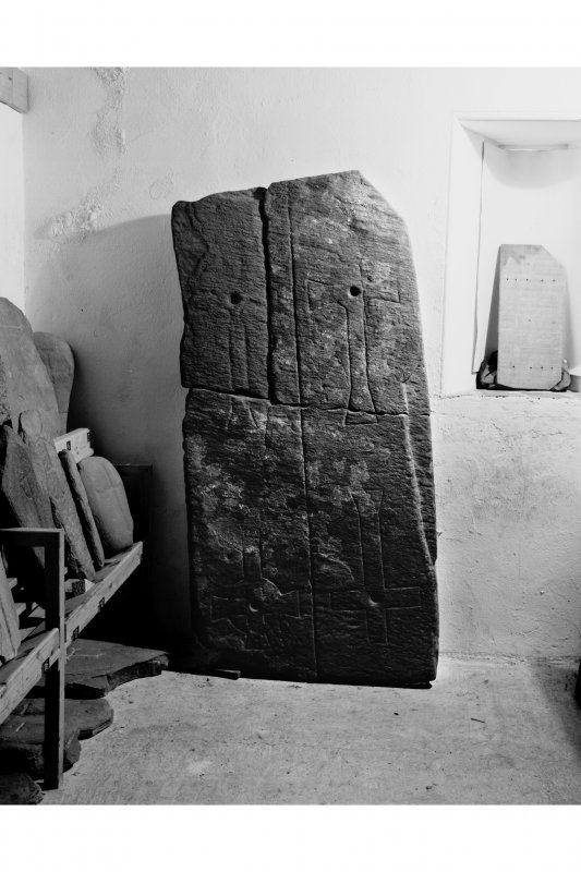 Iona, Iona Abbey museum.  View of Early Christian cross incised slab showing rediscovered fragment in position.