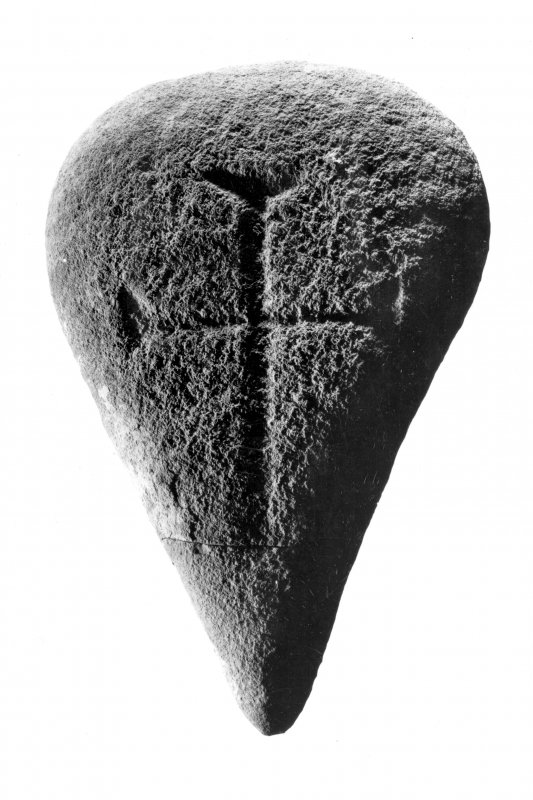 Iona Abbey museum. Cross incised boulder.