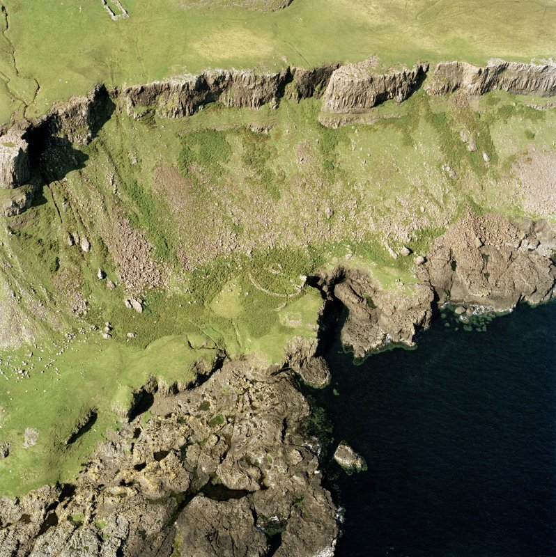 Oblique aerial view of Canna, centred on Sgor nam Ban-Naomha, possible monastic settlement.