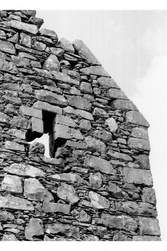 View of exterior of window in upper part of W gable.
