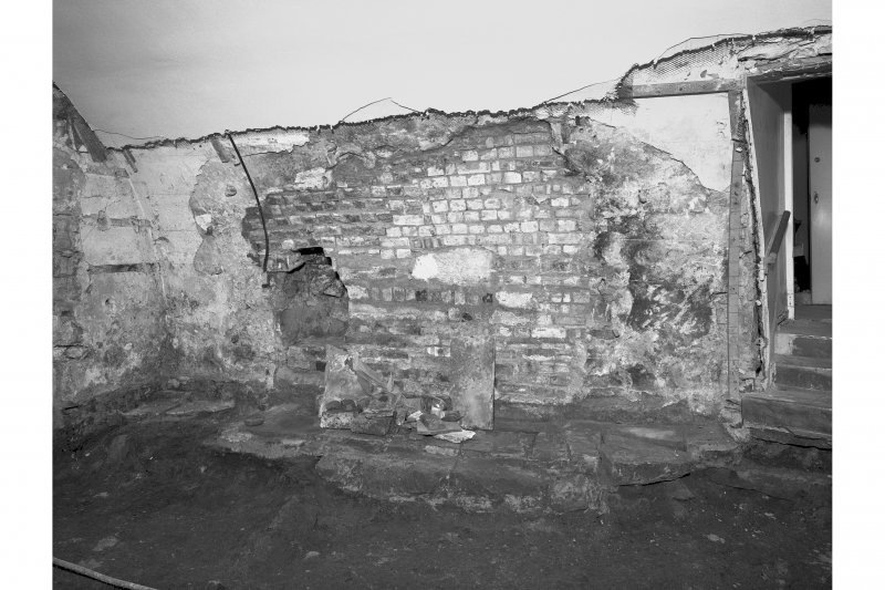 View from South West showing flag floor and brick rebuilding, room 5
