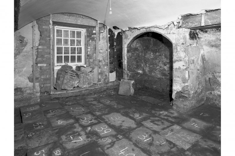 View from North East showing exposed chamfered fireplace and numbered flags, room 6