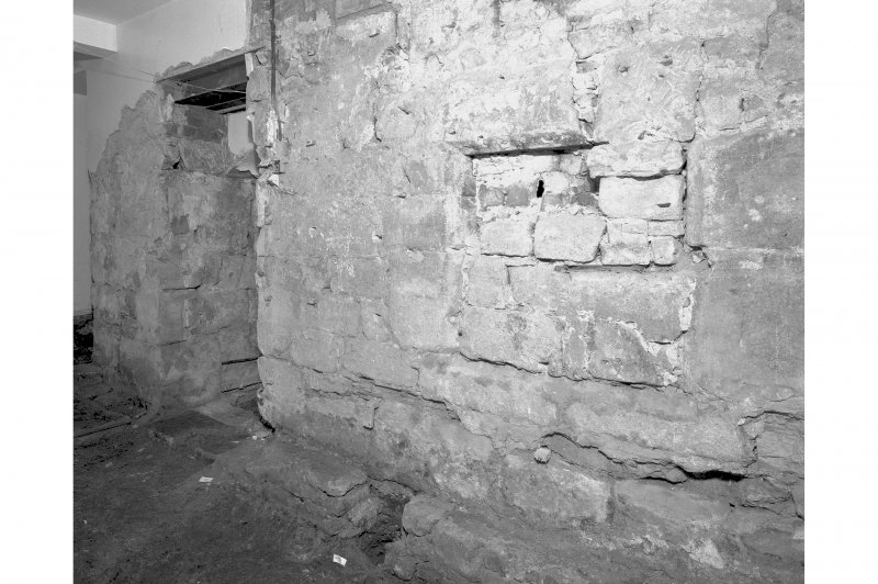 View of South wall showing blocked opening, room 11