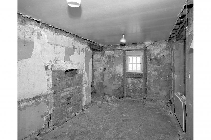 View form South showing blocked fireplace, room 14